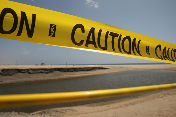 Beach with caution tape